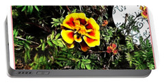 Portable Battery Charger featuring the photograph Orange And Yellow Flower by Joan  Minchak