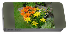 Orange And Yellow Lilies Portable Battery Charger