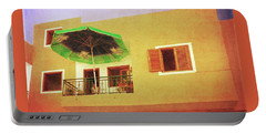 Portable Battery Charger featuring the photograph Orange Apartment, Alcala by Anne Kotan