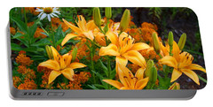 Portable Battery Charger featuring the photograph Orange Asiatic Lilies And Butterfly Weed by Kathryn Meyer