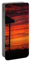 Portable Battery Charger featuring the photograph Orange Balcony Sunset by Bob Slitzan