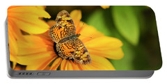 Portable Battery Charger featuring the photograph Orange Crescent Butterfly by Christina Rollo