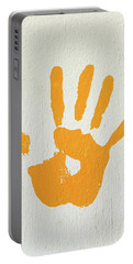 Orange Handprint On A Wall Portable Battery Charger