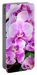 Portable Battery Charger featuring the photograph Orchid Cascade by Jessica Manelis