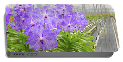 Orchids In A Greenhouse Portable Battery Charger