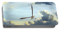 Osprey Flying In Clouds At Sunset With Fish In Talons Portable Battery Charger
