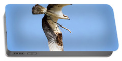 Portable Battery Charger featuring the photograph Osprey In Flight by Ricky L Jones