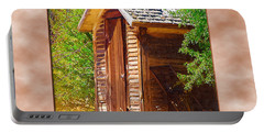 Portable Battery Charger featuring the photograph Outhouse 1 by Susan Kinney