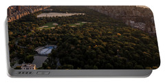 Portable Battery Charger featuring the photograph Over The City Central Park by Anthony Fields