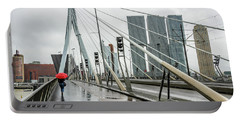 Portable Battery Charger featuring the photograph Over The Erasmus Bridge In Rotterdam With Red Umbrella by RicardMN Photography