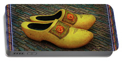 Portable Battery Charger featuring the photograph Oversized Dutch Clogs by Hanny Heim