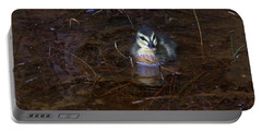 Portable Battery Charger featuring the photograph Pacific Black Duckling by Miroslava Jurcik