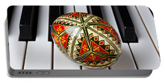Painted Easter Egg On Piano Keys Portable Battery Charger