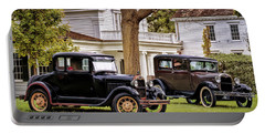 Portable Battery Charger featuring the photograph Pair Of Ford Model A  by Susan Rissi Tregoning