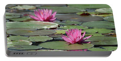 Pair Of Pink Pond Lilies Portable Battery Charger
