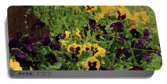 Portable Battery Charger featuring the photograph Pansies by Kim Henderson
