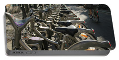 Portable Battery Charger featuring the photograph Paris By Bike by Yoel Koskas