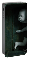 Parts Of A Plastic Doll In A Wooden Box Portable Battery Charger by Lee Avison