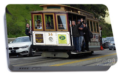 Portable Battery Charger featuring the photograph Passenger Waves From A Cable Car by Steven Spak