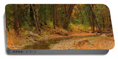 Peaceful Stream Portable Battery Charger by Roena King
