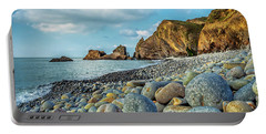Portable Battery Charger featuring the photograph Pebbles On The Beach by Nick Bywater