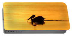 Portable Battery Charger featuring the photograph Pelican Cruising At Sunset In Key West by Bob Slitzan