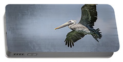 Portable Battery Charger featuring the photograph Pelican Flight by Carolyn Marshall