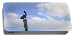Pelican In The Clouds Portable Battery Charger by Christopher L Thomley