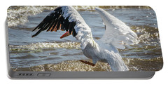 Portable Battery Charger featuring the photograph Pelican Jump by Ray Congrove