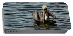 Portable Battery Charger featuring the photograph Pelican Wing In A  Twist by Jean Noren