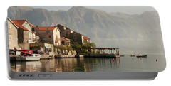 Portable Battery Charger featuring the photograph Perast Restaurant by Phyllis Peterson