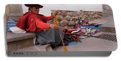 Portable Battery Charger featuring the photograph Peruvian Weaver by Aidan Moran
