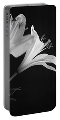 Portable Battery Charger featuring the photograph Petals' Light by Eric Christopher Jackson