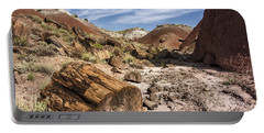 Portable Battery Charger featuring the photograph Petrified Wood In The Painted Desert by Melany Sarafis