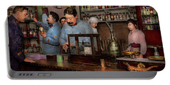Portable Battery Charger featuring the photograph Pharmacy - The Dispensing Chemist 1918 by Mike Savad