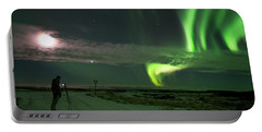 Portable Battery Charger featuring the photograph Photographer Under The Northern Light by Dubi Roman