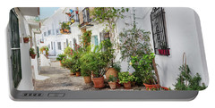Picturesque Narrow Street Decorated With Plants Portable Battery Charger