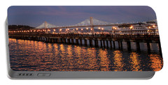 Pier 7 And Bay Bridge Lights At Sunset Portable Battery Charger