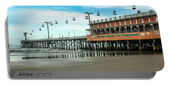 Portable Battery Charger featuring the photograph Pier Daytona Beach by Carolyn Marshall