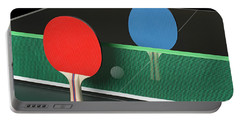 Ping Pong Paddles On Table, Standing Upright Portable Battery Charger