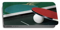Ping Pong Paddles On Table With Net Portable Battery Charger