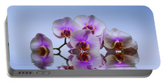 Pink Orchids Blue Background Portable Battery Charger