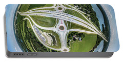 Portable Battery Charger featuring the photograph Planet Of The Roundabouts by Randy Scherkenbach