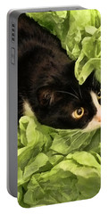 Playful Tuxedo Kitty In Green Tissue Paper Portable Battery Charger by Kathy Clark
