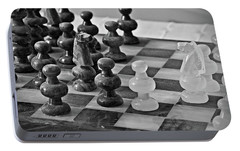 Portable Battery Charger featuring the photograph Playing Chess by Cendrine Marrouat