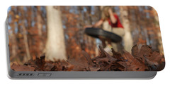 Portable Battery Charger featuring the photograph Playing On The Tire Swing by Greg Collins
