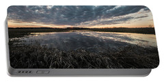 Pond And Sky Reflection5 Portable Battery Charger