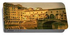 Portable Battery Charger featuring the photograph Ponte Vecchio Morning Florence Italy by Joan Carroll
