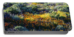Portable Battery Charger featuring the photograph Poppies On A Hillside by Glenn McCarthy Art and Photography