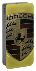 Porsche Emblem On Racing Yellow Portable Battery Charger by Sebastian Musial